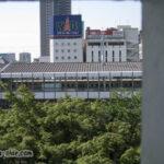 福山城の矢狭間から見える福山駅